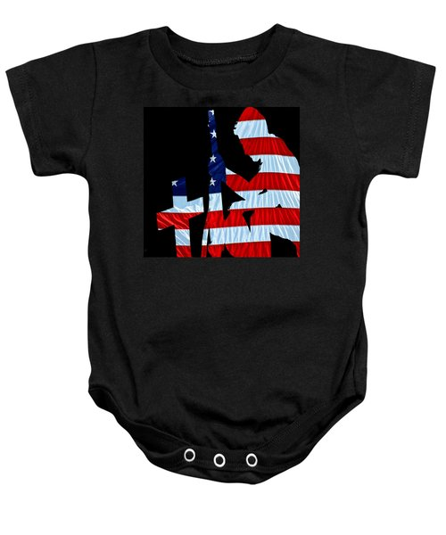 A Time To Remember United States Flag With Kneeling Soldier Silhouette Baby Onesie by Bob Orsillo