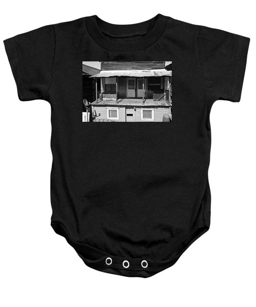 Baby Onesie featuring the photograph Weathered Home With Satellite Dish by Shane Kelly