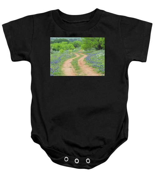 A Dirt Road Lined By Blue Bonnets Of Texas Baby Onesie