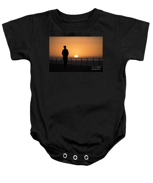 A Woman Silhouetted At Sunset Baby Onesie