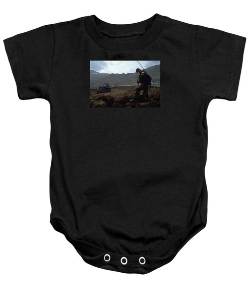 Boots On The Ground Baby Onesie by Travel Pics