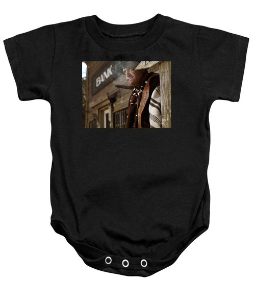 Cowboy Smoking A Cigar Outside Of A Bank Building Baby Onesie