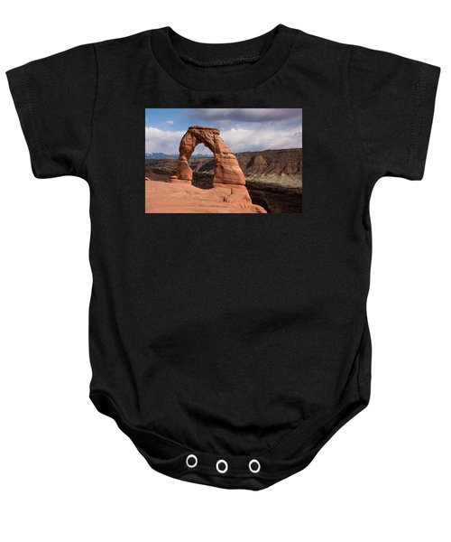 Baby Onesie featuring the photograph Delicate Arch by Jennifer Ancker