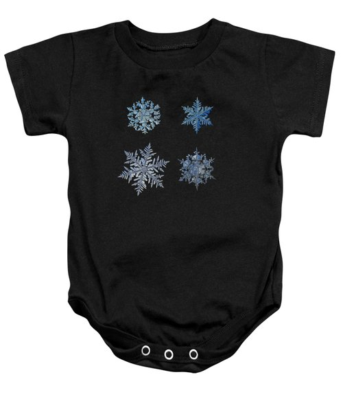 Four Snowflakes On Black Background Baby Onesie