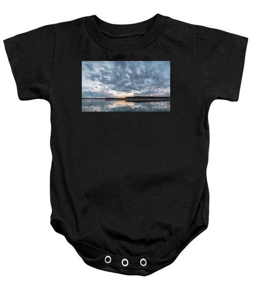 Large Panorama Of Storm Clouds Reflecting On Large Lake At Sunse Baby Onesie