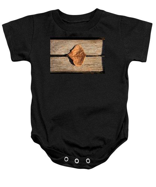 Leaf On Wooden Plank Baby Onesie