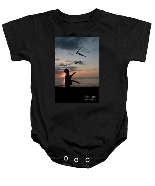 Man Juggling With Four Clubs At Sunset Baby Onesie