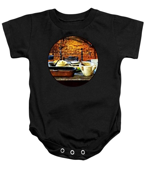 Mortar And Pestles In Colonial Kitchen Baby Onesie by Susan Savad