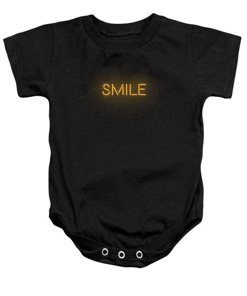 Smile Word In Neon Style Orange Light Baby Onesie