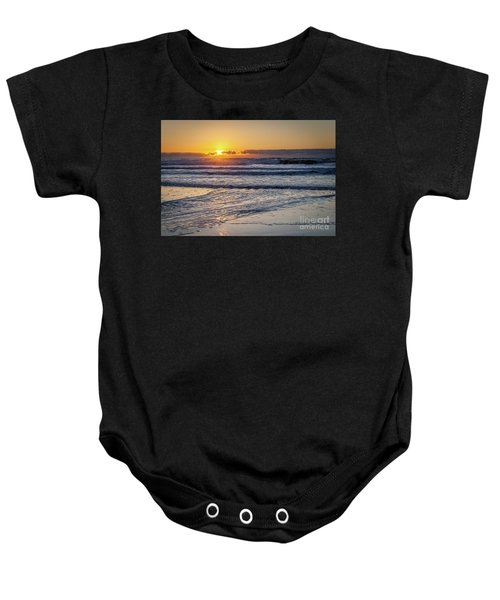 Sun Behind Clouds With Beach And Waves In The Foreground Baby Onesie