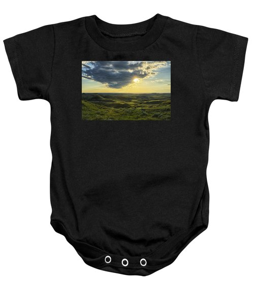 The Sun Shines Through A Cloud Baby Onesie by Robert Postma