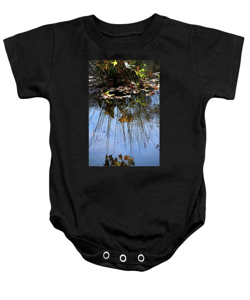 Water Reflection Of Plant Growing In A Stream Baby Onesie