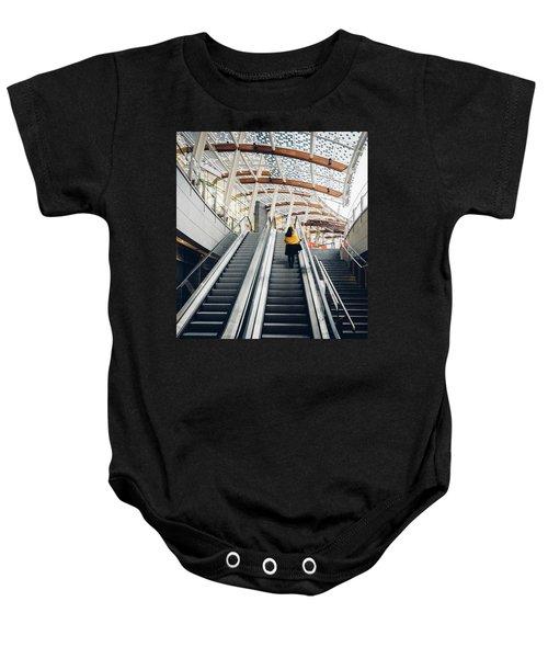 Woman Going Up Escalator In Milan, Italy Baby Onesie