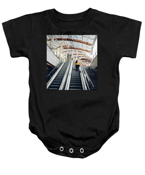 Woman Going Up Escalator In Milan, Italy Baby Onesie
