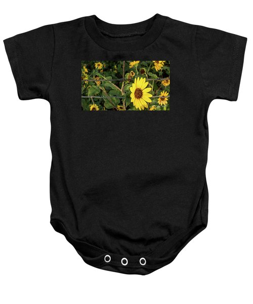 Yellow Flower Escaping From A Barb Wire Fence Baby Onesie