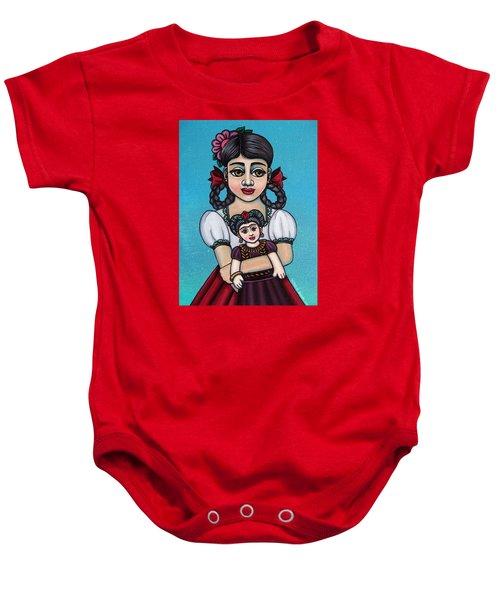 Missy Holding Frida Baby Onesie