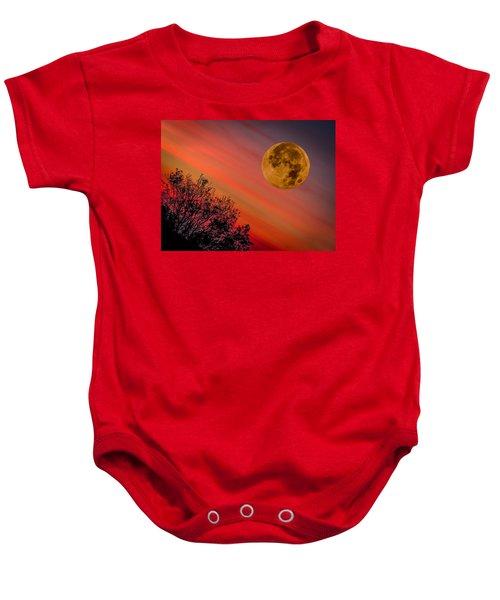 Baby Onesie featuring the photograph Autumn Super Moon And Irish Sunrise by James Truett