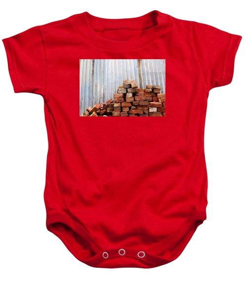 Baby Onesie featuring the photograph Brick Piled by Stephen Mitchell