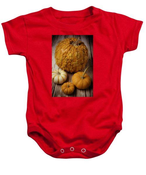 Four Pumpkins Baby Onesie