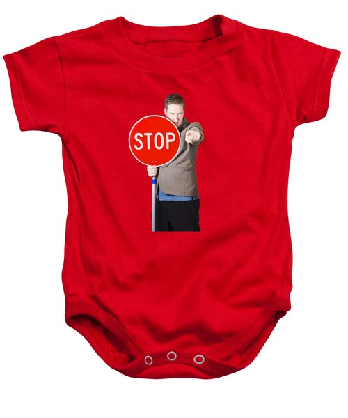 Baby Onesie featuring the photograph Isolated Man Holding Red Traffic Stop Sign by Jorgo Photography - Wall Art Gallery