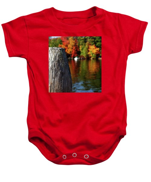 Lake Winnepesaukee Dock With Foliage In The Distance Baby Onesie