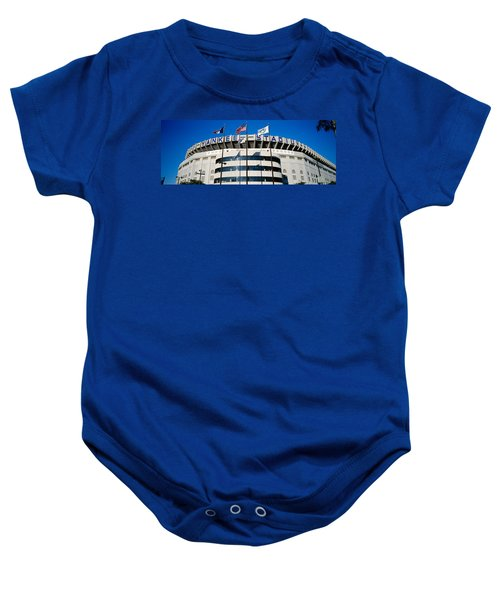 Flags In Front Of A Stadium, Yankee Baby Onesie by Panoramic Images