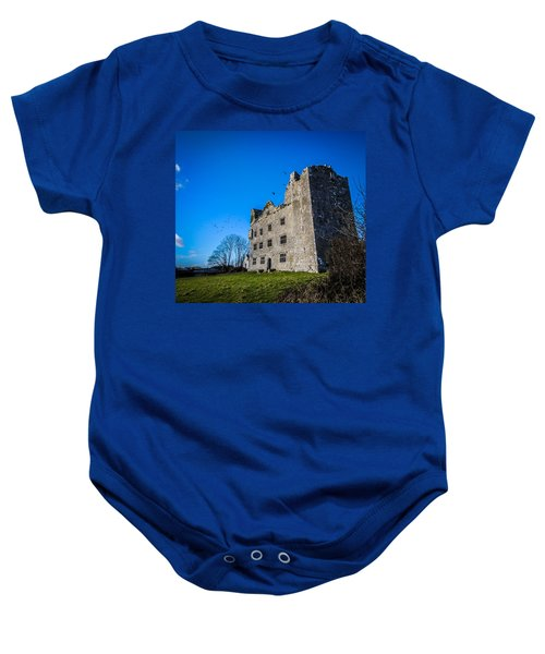 Baby Onesie featuring the photograph Birds Of Ireland's Leamaneh Castle by James Truett