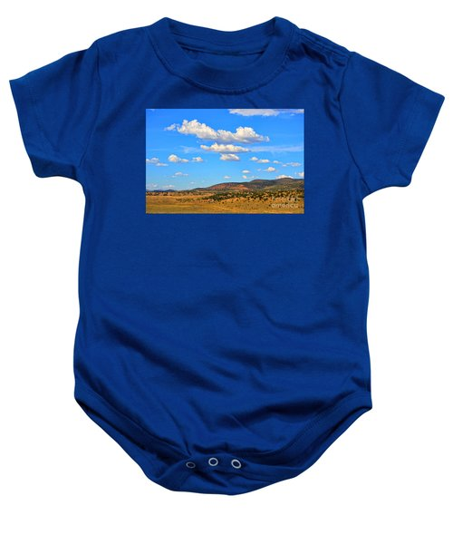 Cloudy Wyoming Sky Baby Onesie