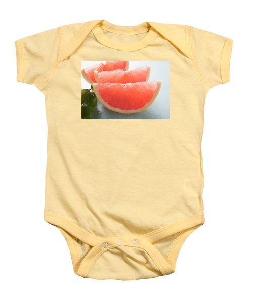 Three Pink Grapefruit Wedges, Leaves Beside Them Baby Onesie