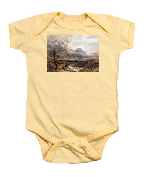 Sun Behind Clouds Baby Onesie by John Linnell
