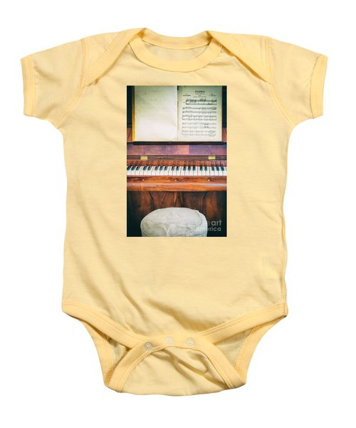 Baby Onesie featuring the photograph Antique Piano And Music Sheet by Silvia Ganora