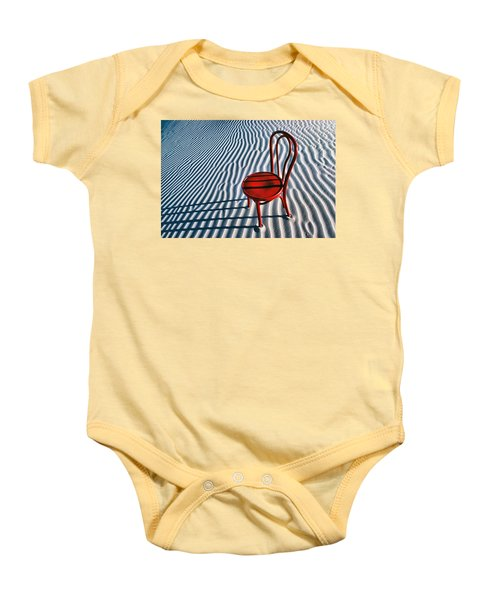 Red Chair In Sand Baby Onesie