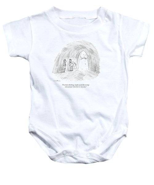 A Cavewoman Talks To A Caveman Who Is Leaving Baby Onesie