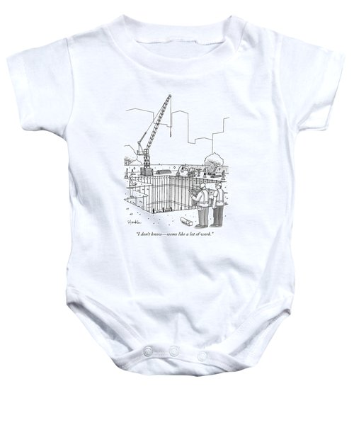 Two Construction Workers Look Out Over A Massive Baby Onesie