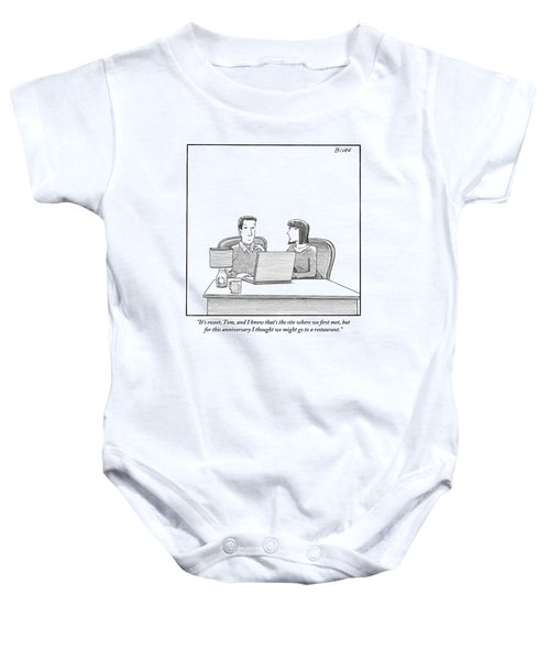 Woman Speaks To Husband As They Sit Behind A Desk Baby Onesie