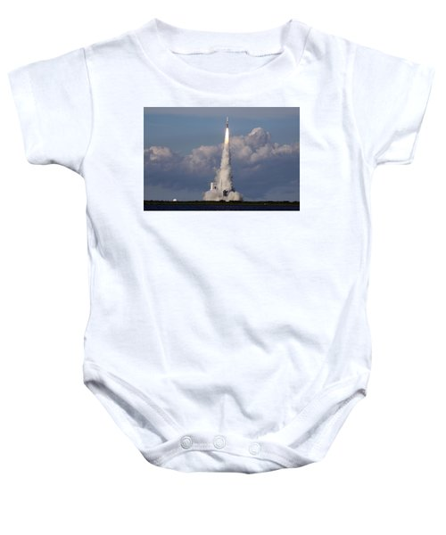 A Delta Iv Rocket Soars Into The Sky Baby Onesie