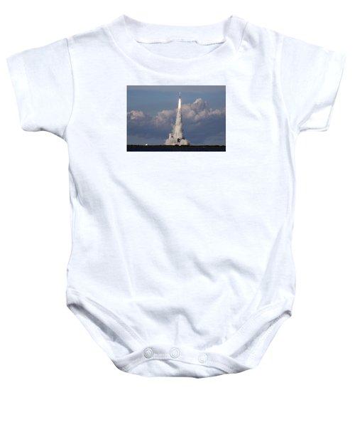 A Delta Iv Rocket Soars Into The Sky Baby Onesie