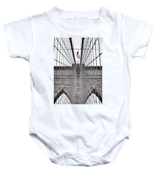 Baby Onesie featuring the photograph Brooklyn Bridge Flag by Peter Simmons