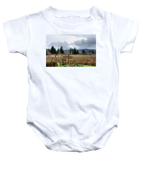 Field, Clouds, Distant Foggy Hills Baby Onesie