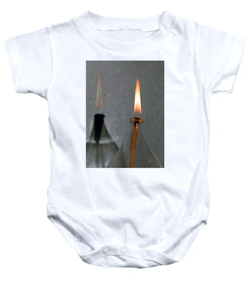 Impossible Shadow Oil Lamp Baby Onesie