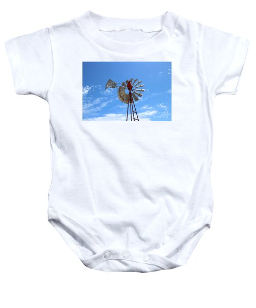 Baby Onesie featuring the photograph Milled Wind by Stephen Mitchell