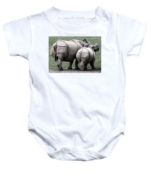 Rhinoceros Mother And Calf In Wild Baby Onesie by Daniel Hagerman