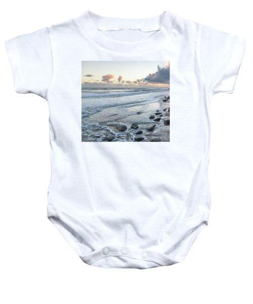 Rocks On The Beach During Sunset Baby Onesie