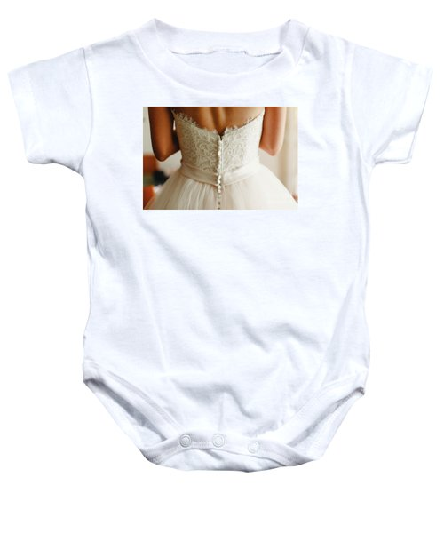 Bride Getting Ready, They Help Her By Buttoning The Buttons On The Back Of Her Dress. Baby Onesie