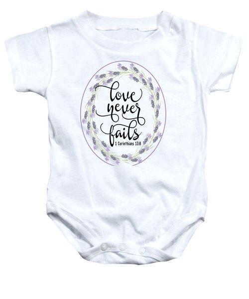 Love Never Fails' Baby Onesie