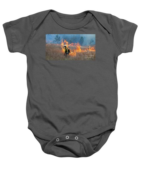 A Firefighter Ignites The Norbeck Prescribed Fire. Baby Onesie