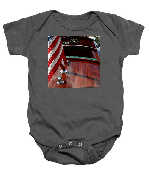 Chris Craft With Flag And Steering Wheel Baby Onesie by Michelle Calkins