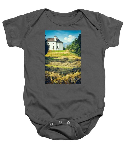 Baby Onesie featuring the photograph Country Church With Hay by Silvia Ganora