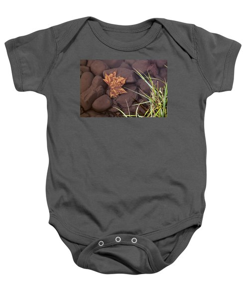 Leaf In The Mountain Fork River Baby Onesie