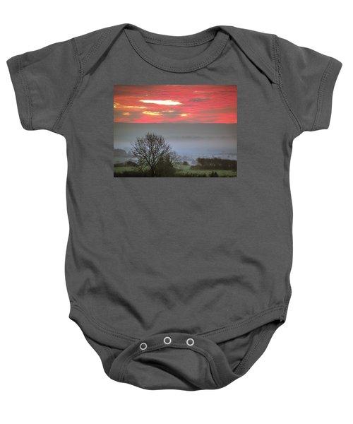 Baby Onesie featuring the photograph Misty Morning Sunrise Over Western Ireland by James Truett